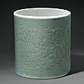 A celadon-glazed carved cylindrical brush pot, China, Qing dynasty, Kangxi period (1662-1722)