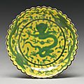 A yellow-ground green-enameled 'dragon' foliate dish, qianlong seal mark and period