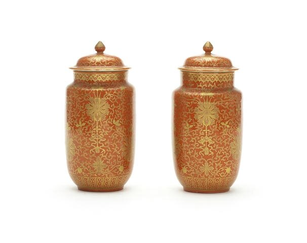 A pair of coral-ground gilt-decorated vases and covers, Shende Tang Zhi hall marks, late Qing Dynasty-Republic Period