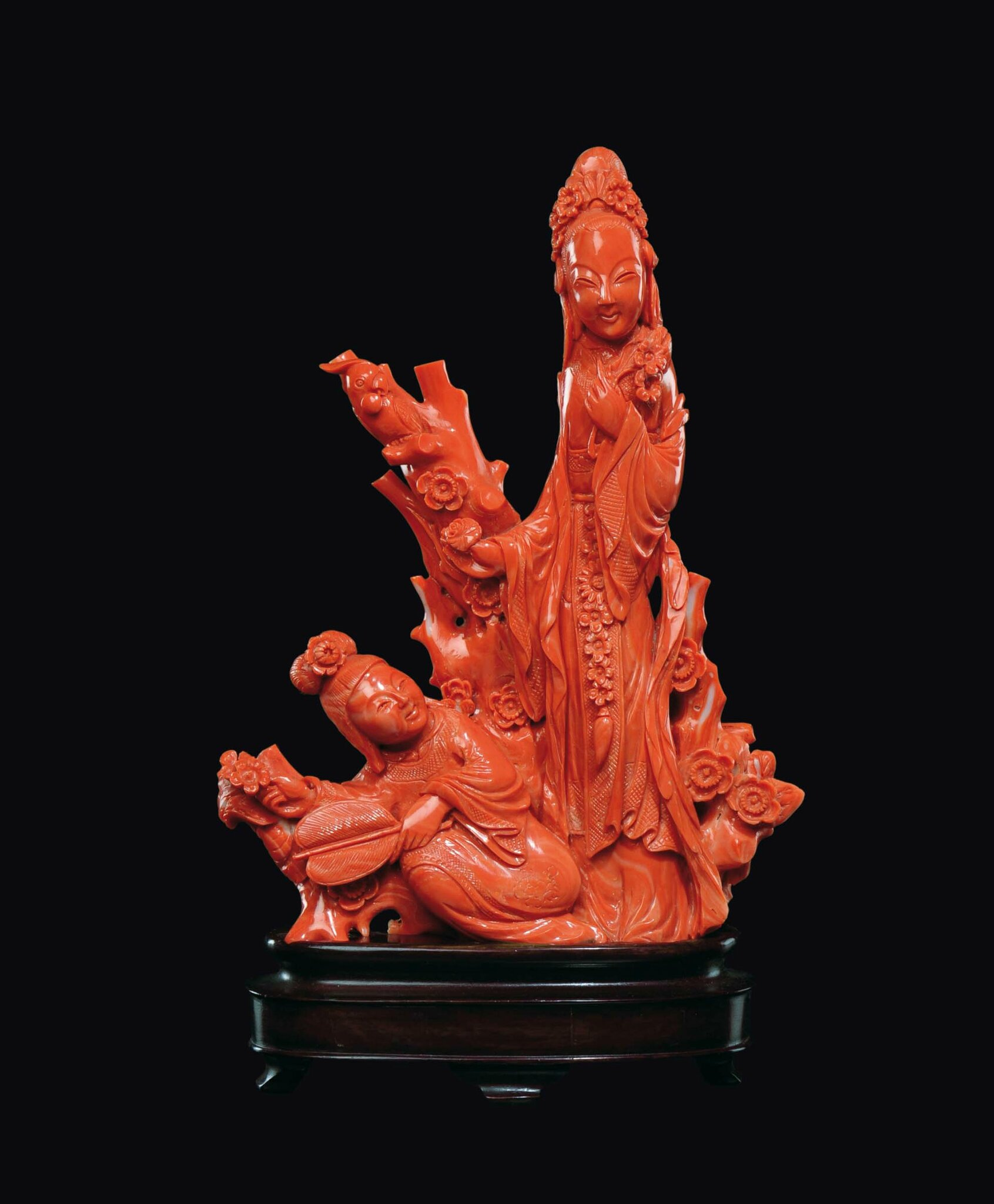"A carved coral ""two Guanyin with fan and flowering branches"" group, China, early 20th century"