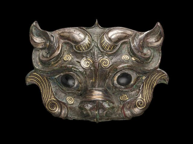 An archaistic gold and silver-inlaid bronze fitting, Song to Ming dynasty