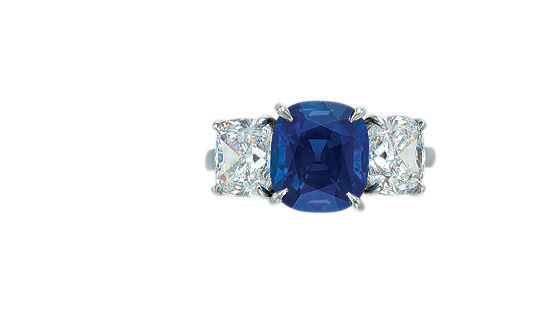 A three-stone sapphire and diamond ring