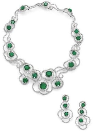 An_emerald_and_diamond_necklace_and_earring_suite