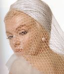 1962_07_10_by_bert_stern_white_veil_color_0010_01a