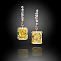 A pair of fancy colored diamond and diamond pendant earrings