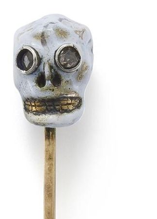 An_early_19th_century_enamel_and_diamond_skull_stick_pin__2_