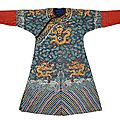 An embroidered blue silk ground dragon robe, 19th century