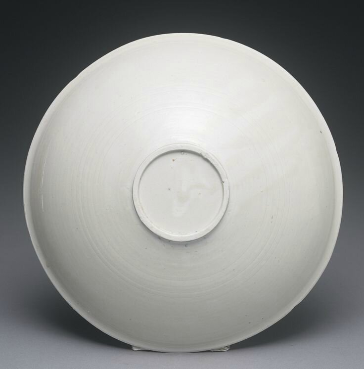 A carved 'Ding' 'Lotus' bowl, Northern Song dynasty3
