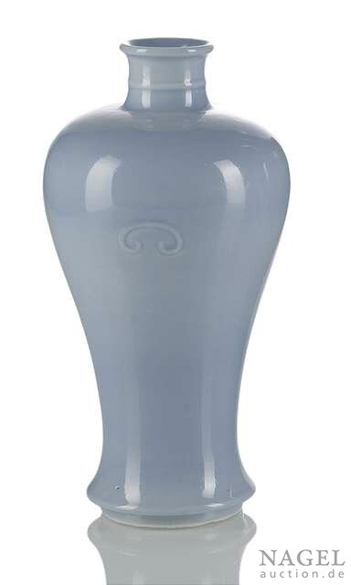 A light-blue glazed porcelain bottle vase with c-shaped decorations, China, underglaze blue Kangxi six-character mark to base
