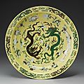 A large green and aubergine yellow-ground biscuit charger, kangxi mark and period (1662-1722)