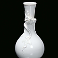 A small Blanc de Chine porcelain ampoule vase with dragon, China, Dehua, 17th century