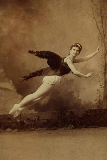 Helene Levy In winged costume, posed in mid air ca
