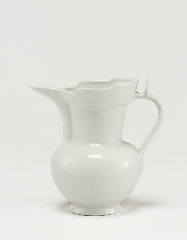 A rare white 'Monk's Cap' ewer incised with tibetan inscription, Ming dynasty, Yongle period
