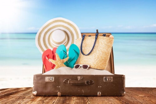 old-suitcase-with-accessories-on-beach_width500-height