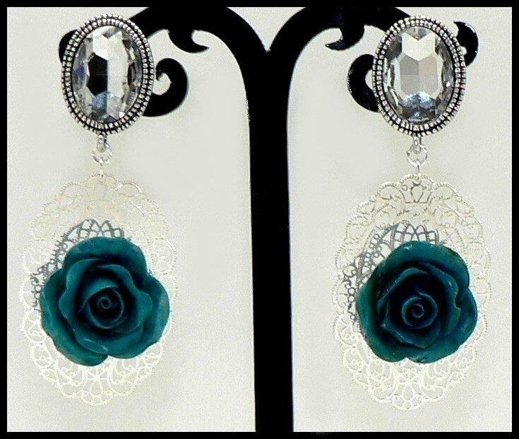Clips cristal et roses en porcelaine froide sur estampes