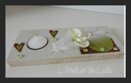 centre de table mariage orchidee plumes