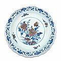 A rare ming-style blue and white and copper-red barbed-rim dish, qianlong seal mark and of the period (1736-1795)
