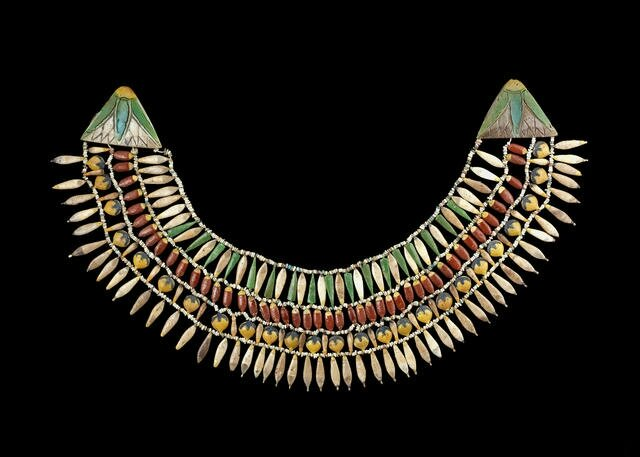 An Egyptian polychrome glazed composition beaded broad collar necklace, New Kingdom, late 18th Dynasty, Amarna Period