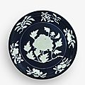 An exceptionally rare and large fine blue and white reserve-decorated 'peony' dish, Xuande mark and period