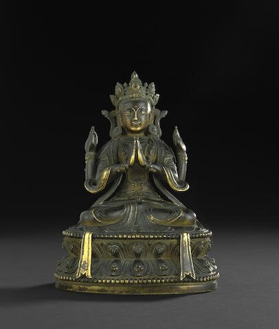 An inscribed gilt bronze seated figure of Shadakshari Lokeshvara, Kangxi period, dated to 1680