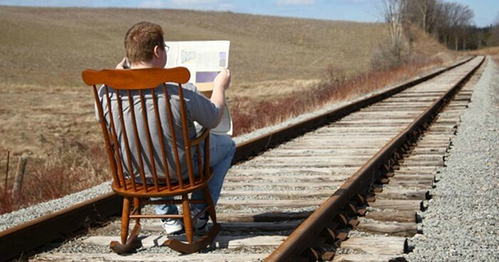man-rocking-chair-train-track
