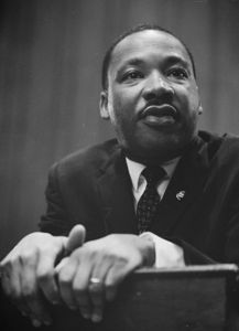 434px_Martin_Luther_King_1964_leaning_on_a_lectern