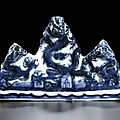 A blue and white 'three-dragon' brushrest, Mark and period of Wanli