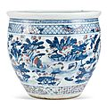 A blue and white and underglazed-red 'crane and lotus' fish jar, Qing dynasty, 18th – 19th century