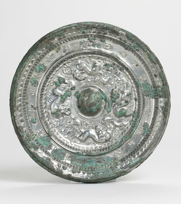 A bronze'Mythical Beasts' mirror with inscription, Sui-Early Tang dynasty