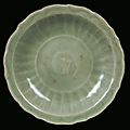 A longquan celadon porcelain plate with fishes, china, yuan dynasty (1279-1368)