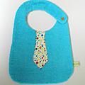 Bavoir cravate Turquoise étoiles multicolores