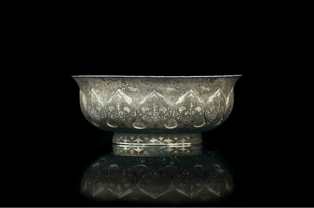A rare repoussé and parcel-gilt silver bowl, Tang dynasty, early 8th century