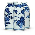 A blue and white 'flowers of the four seasons' conjoined vase, Qianlong four-character seal mark in underglaze blue and of the period (1736-1795)