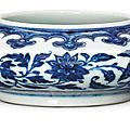 A fine ming-style blue and white 'floral scroll' water pot, yongzheng six-character mark and of the period (1723-1735)