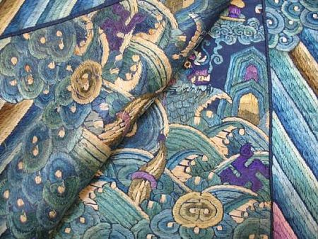 A_fine_blue_silk_ground_embroidered_dragon_robe7