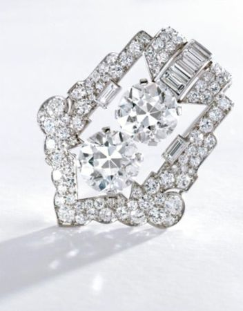 PLATINUM_AND_DIAMOND_CLIP_BROOCH__CARTIER__CIRCA_1925