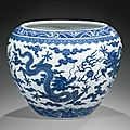 A large blue and white 'dragon' jardinière, china, qing dynasty, qianlong seal mark and period