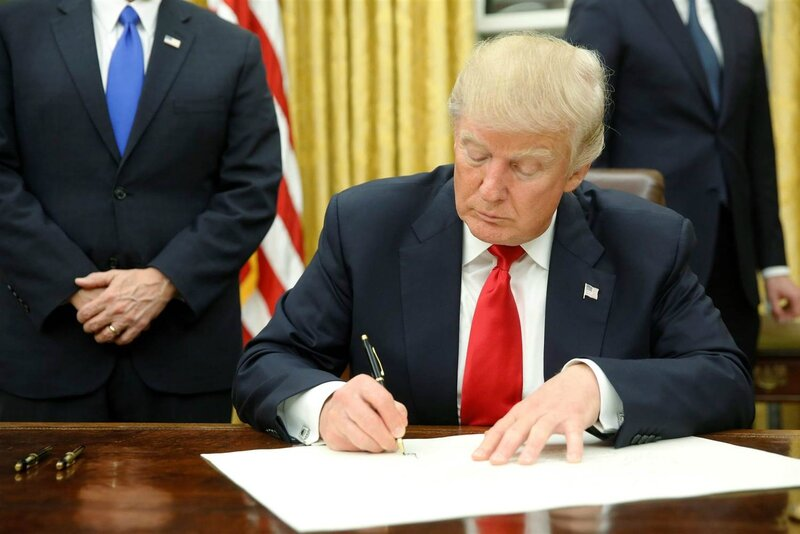 Donald Trump signs his first exec order