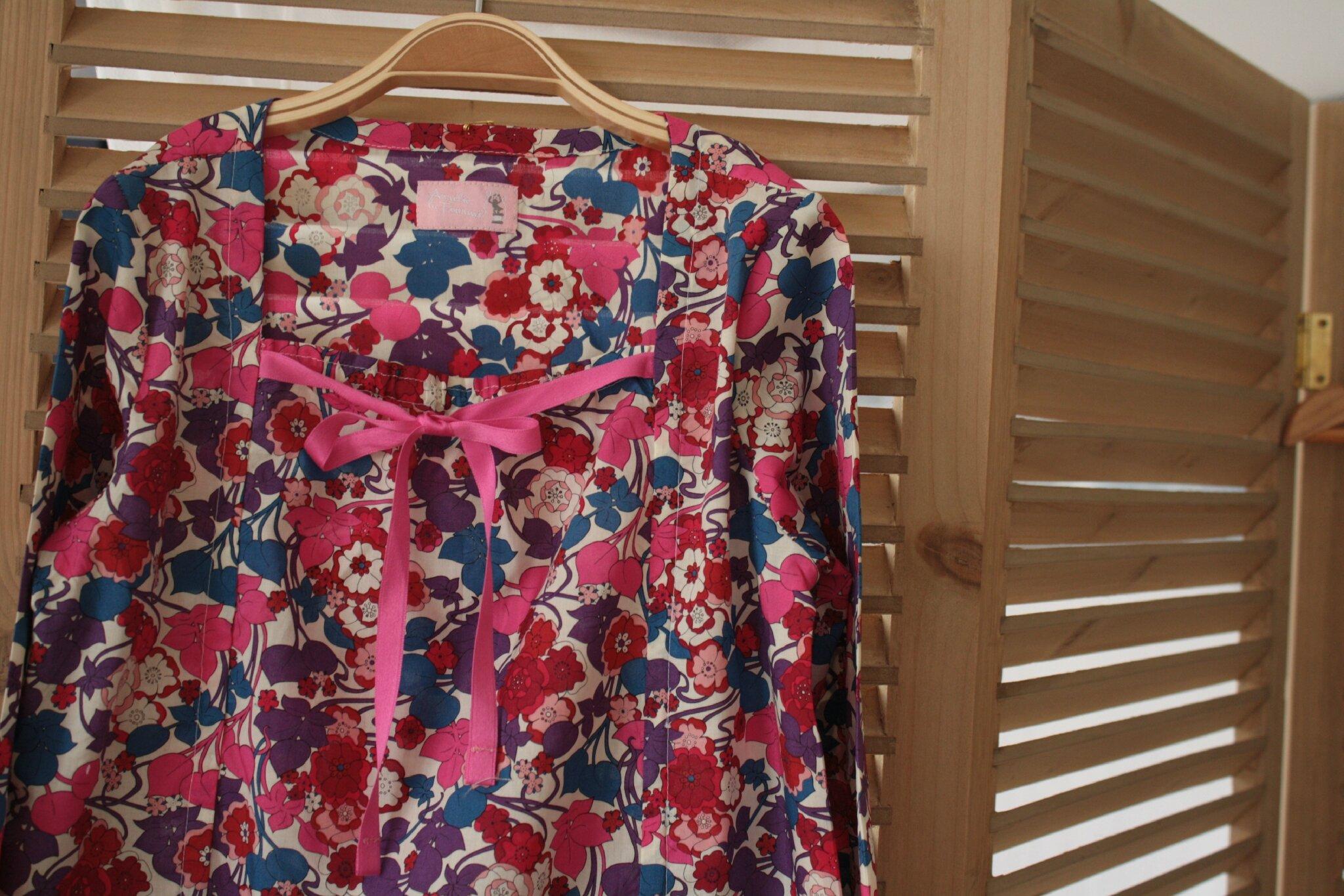 blouse Liberty 8 ans, nouée devant, manches longues, 30€