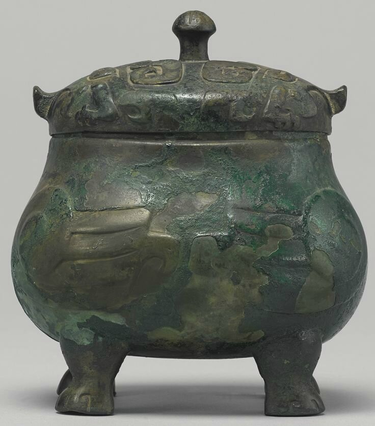 A rare bronze double-owl-form  ritual food vessel (you), Late Shang dynasty, 13th-11th century BC