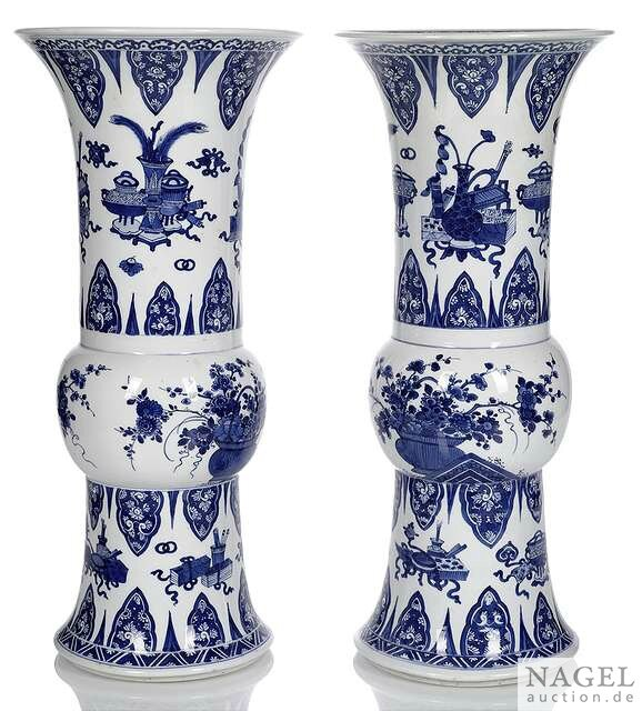 A fine pair of blue and white porcelain vases with antiques and flowers, China, Kangxi period