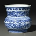 A rare blue and white, 'flower scroll' zhadou, qianlong six-character seal mark in underglaze blue and of the period