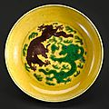 A green and aubergine-glazed yellow ground dragon dish. Jiaqing mark and period.