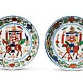 A pair of wucai 'qilin' dishes, Wanli six-character marks within double circles and of the period (1573-1620)