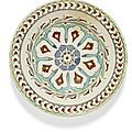 An iznik polychrome pottery dish with a lobed arch design, turkey, circa 1600