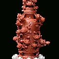 A red coral sculpture representing a vase with floral shoots, China, Qing Dynasty, 19th century