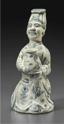 A very rare blue and white kneeling figure of an official, Vietnam, 15th-16th century