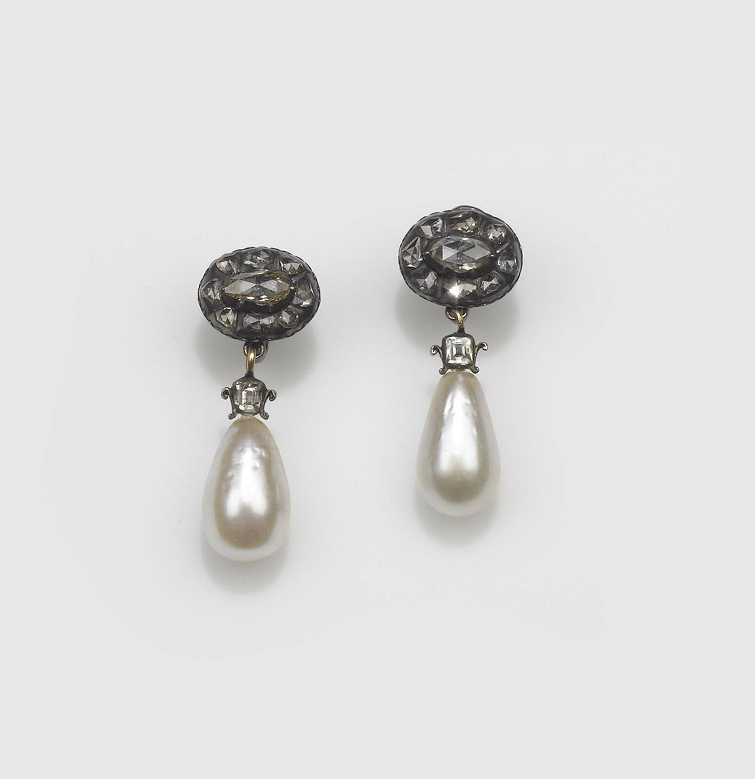 An impressive pair of natural saltwater drop pearl and rose-cut diamond