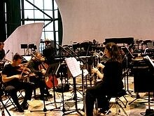 220px-Music-for18-musicians-performance
