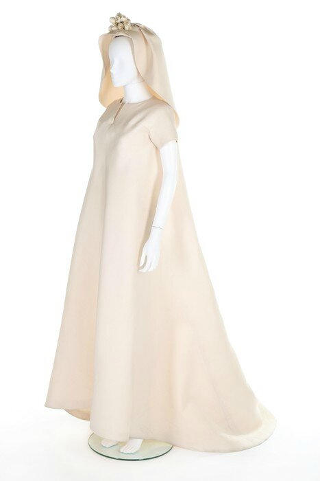 Record Breaking Fashion Auction for a Balenciaga couture ivory slubbed silk gazar bridal gown and veil
